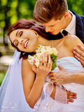 Bride and groom with flower outdoor Stock Photography
