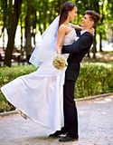 Bride and groom with flower outdoor. Royalty Free Stock Photos