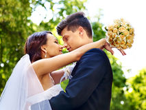 Bride and groom with flower outdoor. Royalty Free Stock Images