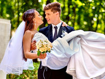Bride and groom with flower outdoor Stock Images