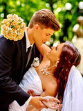 Bride and groom with flower outdoor Stock Photo
