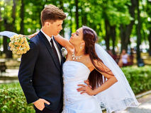Bride and groom with flower outdoor Royalty Free Stock Photography