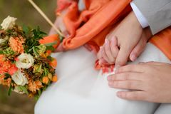 Bride and groom with flowers Stock Photo