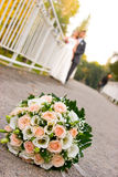 Bride and groom with flowers in front Royalty Free Stock Photo
