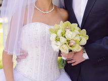 Bride and Groom with Flowers Royalty Free Stock Photography