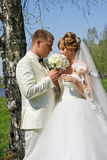Bride and groom with flowers Stock Photography
