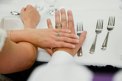 Bride & Groom Focus on Hand. Every bride and Groom love to admire their sparkling new wedding rings right after their ceremony.  This simple shot focusses on Stock Images