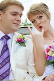 Bride and groom fooling with funny expressions Royalty Free Stock Photo