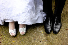 Bride and groom foot. Detail of bride and groom feet Royalty Free Stock Images