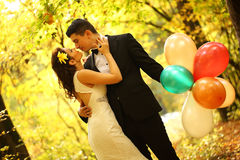 Bride and groom in a forest Stock Photo