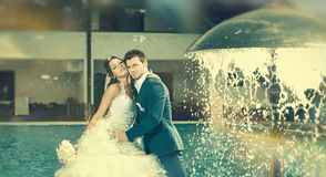 Bride and Groom at fountain Stock Photography