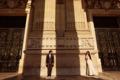 Bride and groom in front of a big building Royalty Free Stock Images