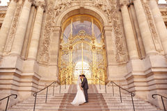 Bride and groom in front of a big building Stock Images