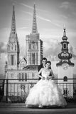 Bride and groom in front of cathedral bw Royalty Free Stock Photo