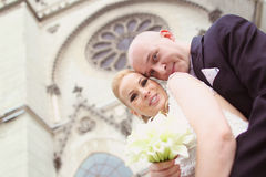 Bride and groom in front of the church Royalty Free Stock Images