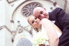 Bride and groom in front of the church Royalty Free Stock Photo