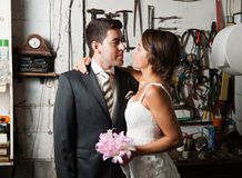 Bride and groom in a garage Royalty Free Stock Image