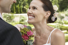 Bride And Groom In Garden Royalty Free Stock Photography
