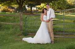 Bride and groom in garden wedding Royalty Free Stock Photo