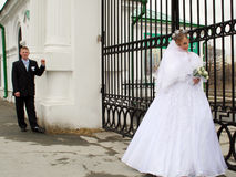 Bride and groom at gate stock photos