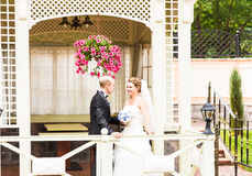 Bride and groom in the gazebo Royalty Free Stock Photo