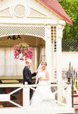 Bride and groom in the gazebo Stock Photos