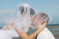 Bride and groom gentle kiss Stock Photo