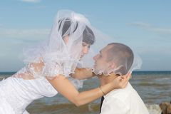 Bride and groom gentle kiss Stock Image