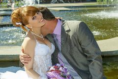 Bride and groom gentle kiss Royalty Free Stock Photos