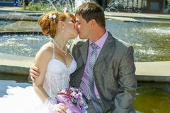 Bride and groom gentle kiss Stock Photography