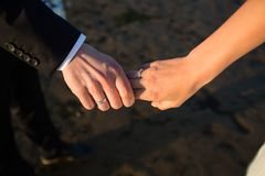 A pair of hands hold each other stock image