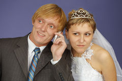 Bride and groom get phone call Stock Photo