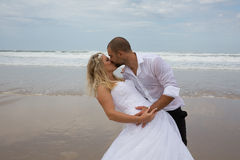 Bride and groom getting married by the beach Stock Photography