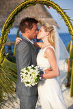 Bride And Groom Getting Married In Beach Ceremony Royalty Free Stock Images