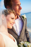 Bride And Groom Getting Married In Beach Ceremony Royalty Free Stock Photo