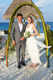Bride And Groom Getting Married In Beach Ceremony Royalty Free Stock Image
