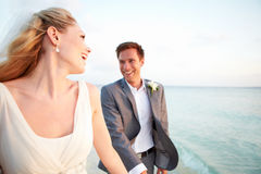 Bride And Groom Getting Married In Beach Ceremony Stock Photos