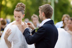 Bride and groom getting ready for a wedding Royalty Free Stock Photo