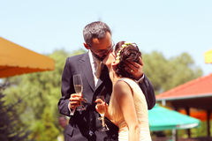 Bride and groom with glass of champagne Royalty Free Stock Photo