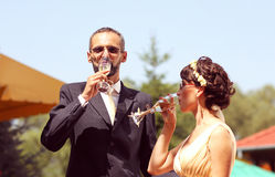 Bride and groom with glass of champagne Stock Image