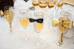 Bride and groom glasses stock photo