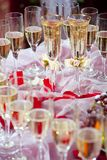 Bride and groom glasses of champagne Royalty Free Stock Images