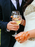 Bride and groom with glasses of champagne Stock Photos