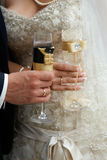 Bride and groom with glasses of champagne Royalty Free Stock Image
