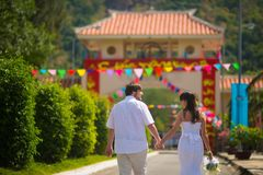 Bride and groom, going to the summer Park outdoors, holding hands stock image