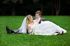 Bride and groom on grass Stock Photography