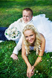 Bride and groom on grass Stock Images