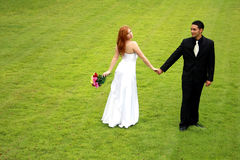 Bride and Groom on Green Lawn Royalty Free Stock Photo