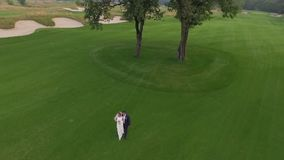 Bride and groom on a green lawn top view stock footage