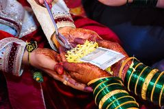 Bride and groom at Haldi ceremony a couple days before a Hindu wedding stock images